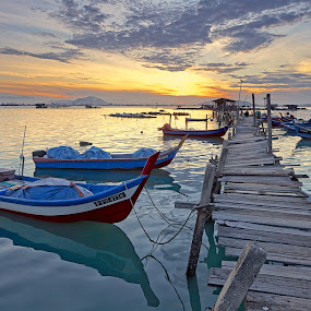 Parked by Christopher Harriot - Transportation Boats ( fishing boats, penang, fishing, jetty, rickety, wooden bridge, dock, unsafe )