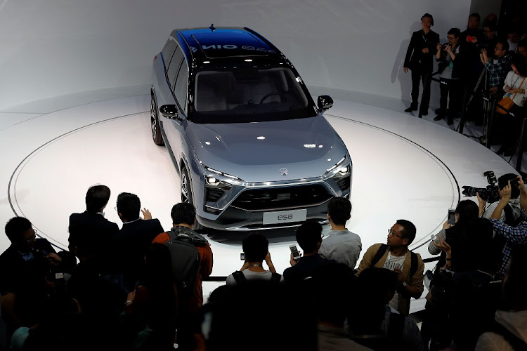 People inspect one of Chinese electric vehicle start-up NIO's SUVs in Shanghai, China. File photo: REUTERS