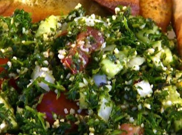 TABOULI  1 cup water 1 cup fine cracked wheat 1 cup minced fresh parsley leaves 1/2 cup minced...