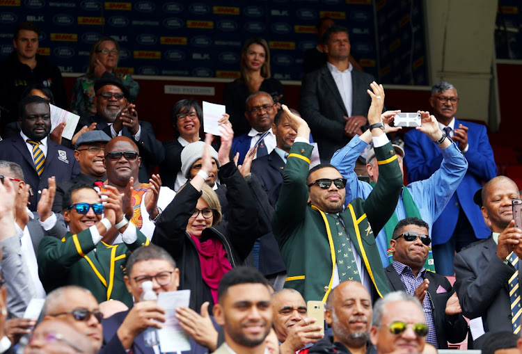 Ex-Springboks Breyton Paulse, left, and Bryan Habana, with Nelson Mandela's former personal assistant Zelda la Grange between them, take part in a minute-long final ovation for Chester Williams at his funeral on September 14 2019 t Newlands stadium in Cape Town.