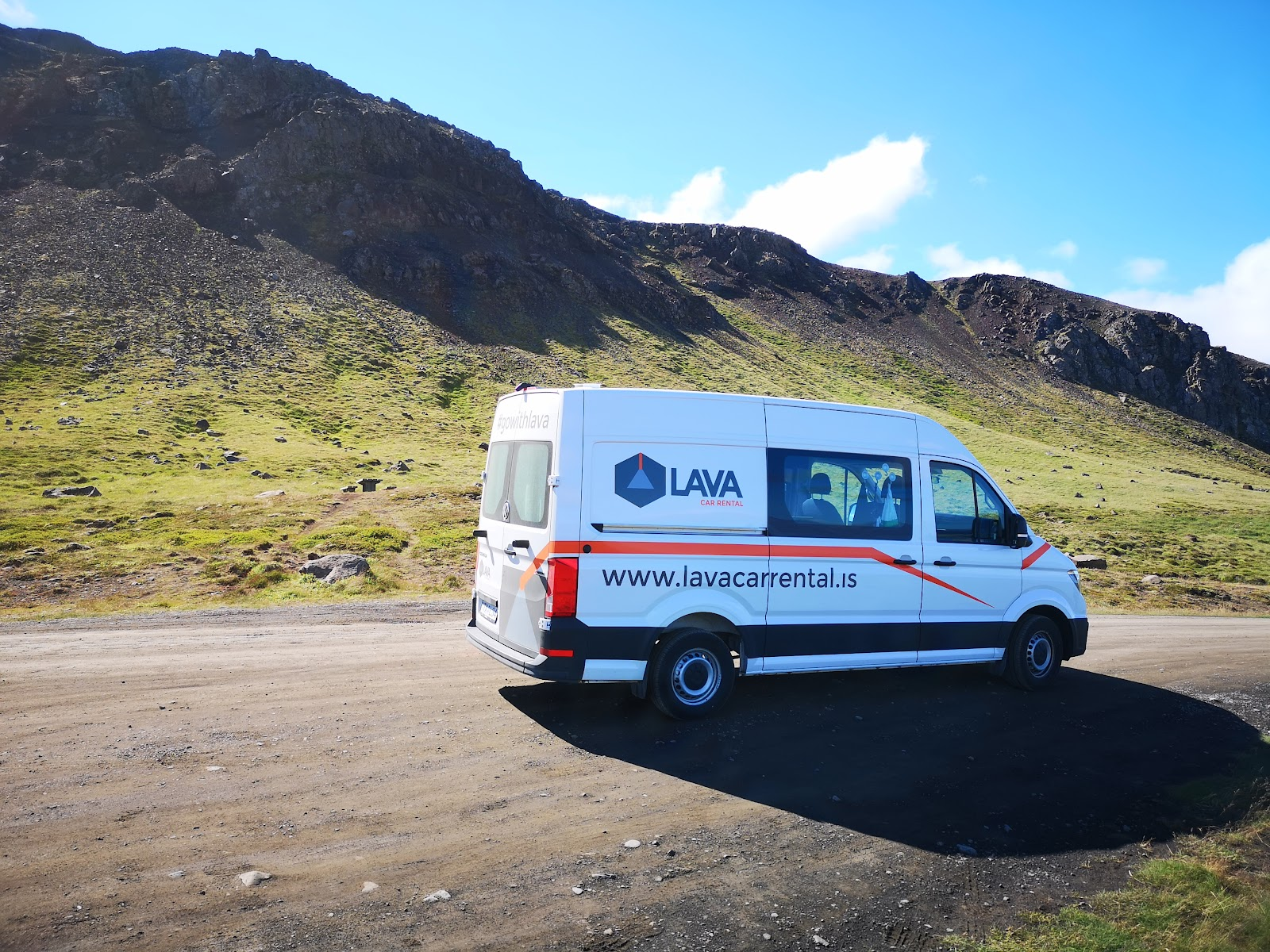 Campervan in Iceland on a mountain road.