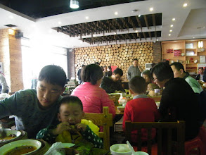 Photo: last breakfast feature southern China cuisine offered by kid brother couple, with their 2 kids.