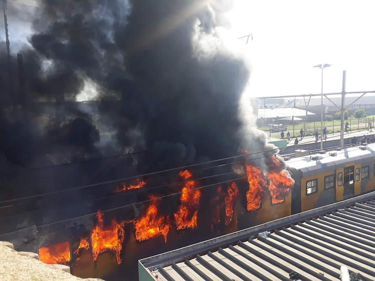 A train goes up in flames at Koeberg station in Cape Town on August 21' 2018.