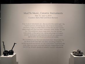 "Photo: Exhibition of ceramic musical instruments at The Bascom Arts Center in Highlands, NC. The exhibit, curated by Barry Hall and Brian Ransom, features musical instruments created by ceramic artists from around the world, as featured in the book ""From Mud to Music"" by Barry Hall."