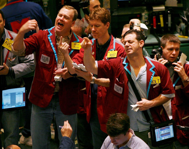 Oil traders work in the pit of the New York Mercantile Exchange in New York, US. Picture: REUTERS/SHANNON STAPLETON