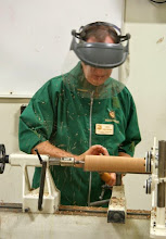 Photo: ...Allen quickly rounds up the turning square with a spindle roughing gouge.