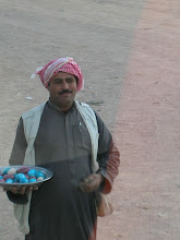 Photo: a Bedouin selling rocks for $1