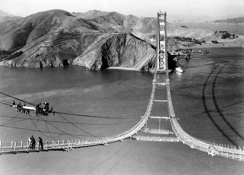 Photo: Workers complete the catwalks for the Golden Gate Bridge, hundreds of feet above the strait below, prior to spinning the bridge cables during construction on October 25, 1935. (AP Photo)