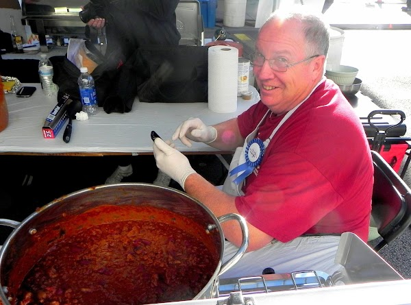 "This is ""Fireman Bob"" Cooney cookin' up his famous http://www.justapinch.com/recipes/main-course/beef/fireman-bobs-fire-house-chili.html at the WFC and..."