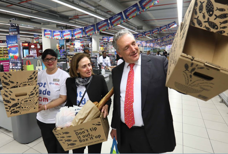 Pick n Pay V&A Waterfront supervisor Ruwayda Kenyon, transformation director Suzanne Ackerman-Berman and chair Gareth Ackerman with the R5 boxes sold on Tuesday as an alternative to plastic bags. Picture: ESA ALEXANDER