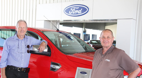 A CHANGE OF DRIVER: Ken Flower will take over as general manager, and eventually dealer principal, of Kaputar Motors from Laurie Godden, who is retiring after setting up the business 11 years ago. Mr Godden is holding an award the dealership has won from the Ford Motor Company for the past 10 years in a row, for achieving its sales targets.