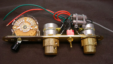 Photo: Parallel single-coil and humbucking signal paths selected by an on-on toggle switch. Independent volume and tone on each path via CTS concentric 250K/500K pots. Custom 3-wafer 6-pole 5-way switch maintains signal separation. Dual PIO caps, one for each circuit. All fitted to a standard Telecaster control plate.