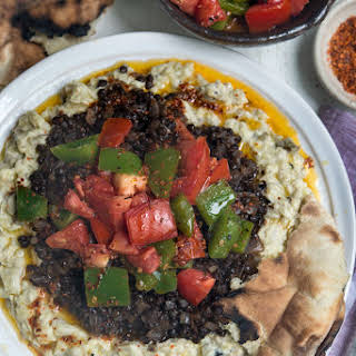 Smoky Eggplant Topped with Black Lentils, Tomatoes, Bell Peppers and Spiced-Chile Butter.