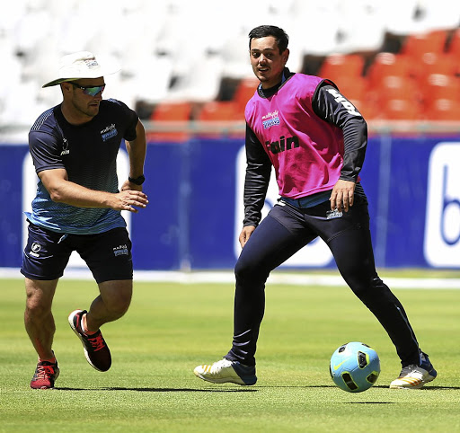 Different ball game: Titans coach Mark Boucher, left, and Quinton de Kock loosen up with a football. Boucher slammed critics who complained about his decision to field a weakened team in their defeat to the Dolphins. Picture: SHAUN ROY/GALLO Images