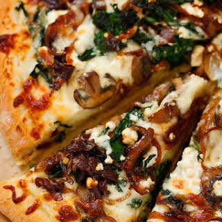 Caramelized Onion Feta Spinach Pizza with White Sauce.