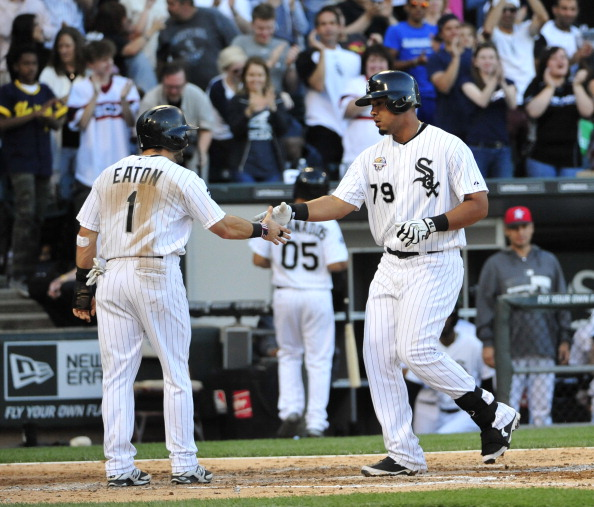 CHICAGO, IL - JULY 04: Jose Abreu #79 of the Chicago White Sox is greeted by Adam Eaton #1  after hitting a tow-run homer against the Seattle Mariners during the fifth inning on July 4, 2014 at U.S. Cellular Field in Chicago, Illinois.  (Photo by David Banks/Getty Images)