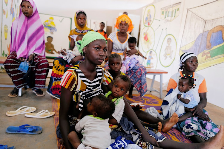 Habibou Sore, 22, who said she fled her village in northern Burkina Faso barefoot and heavily pregnant as suspected Islamist gunmen approached, waits for her sixteen-month-old twins, who suffer from malnutrition, to be examined at a hospital in Kaya, Burkina Faso on November 23, 2020. File photo