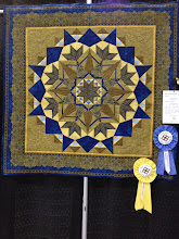 "Photo: 806 Special Award: Machine Quilting – ""Monumental Star,"" Edith Shaver and Linda McCuean"