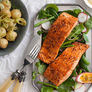 GRILLED SALMON STEAKS WITH PASSION FRUIT HOLLANDAISE SAUCE.
