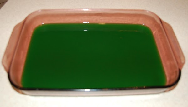 Disolve gelatin in boiling water.  Add juice and green food coloring (if desired)....