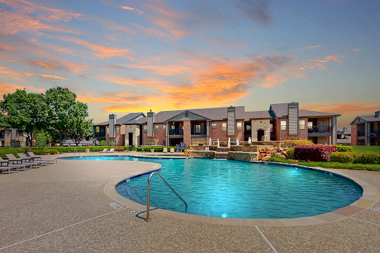 The Club at Riverchase apartment swimming pool with fountain at dusk