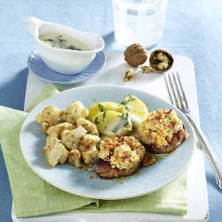 Walnut-Crusted Pork Chops with Cauliflower and Bechamel Sauce.