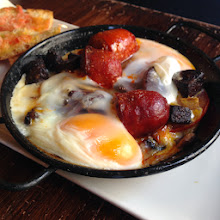 Photo: Baked eggs with chorizo and sausage