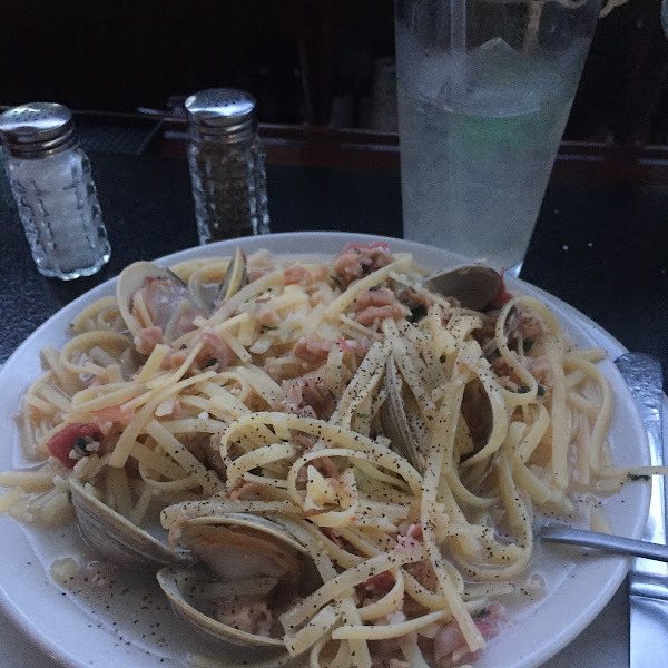 Clam Linguini with light sauce served with salad with gluten free croutons
