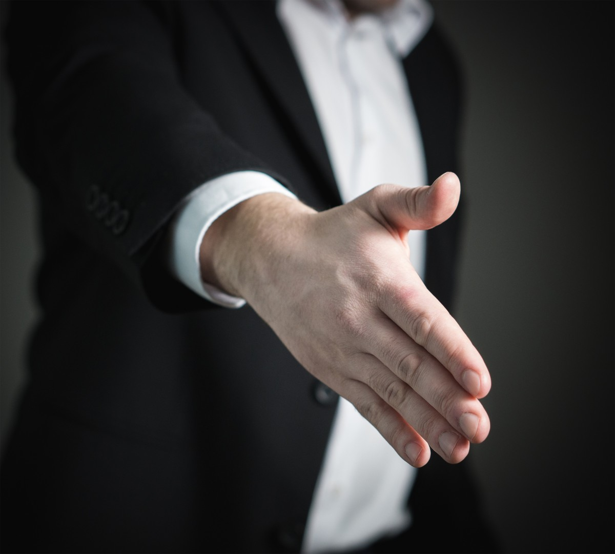 hand man finger giving corporate business arm groom settlement tuxedo partnership contract trade sale buy job handshake greeting sell congratulations give businessman marketing deal offer interaction cooperation agreement real estate agent sense hiring formal wear synergy collaboration job interview congrats