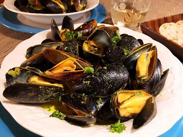 Mussels Served On A White Plate.
