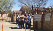 A group of mothers gathered at the school gate, praying for the safe return of the little girl.