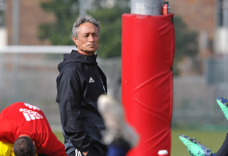 Ajax Cape Town head caoch Muhsin Ertugral takes charge of a training session.