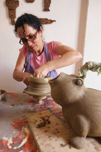 Cuban-Woman-Making-Pottery2.jpg - A Cuban potter at work.