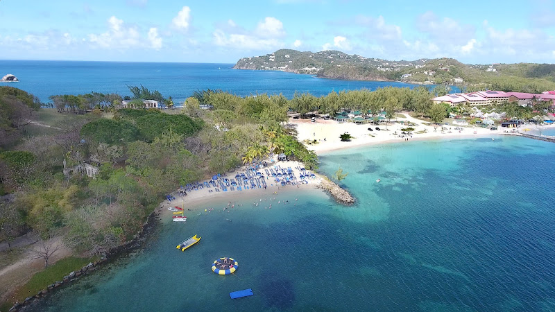 Drone shot of the blue Atlantic and turquoise Rodney Bay at Pigeon Island, a national park in the north of St. Lucia.