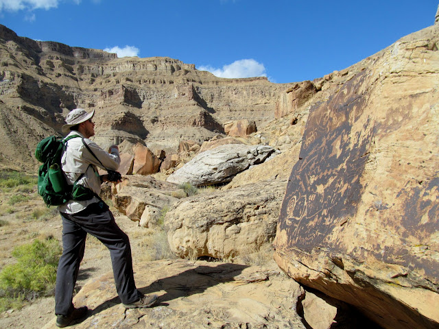 Checking out some petroglyphs on a boulder