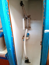 Photo: house raw water intake and strainer now located in wet locker just forward of nav station