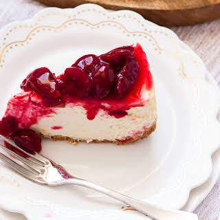 Easy Baked Cheesecake with Fresh Cherry Sauce.