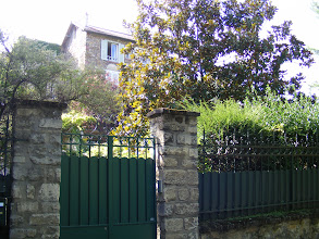 Photo: After about a mile walk, I arrive at the banks of the Marne river (which ends a bit north of here, where it joins the Seine) with homes like this partially hidden behind trees and fences.
