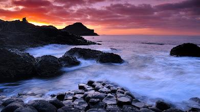 Photo: sunset on hexagonal basalt columns, giant's causeway, north coast, county antrim