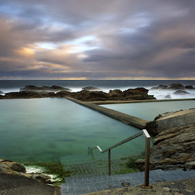 Time for a swim! by Jason Asher - Landscapes Waterscapes ( railing, water, blue pool, waterscape, bermagui, sea, ocean, nsw, new south wales, seascape, beach, dusk, coastal, swimming, coast, pool, sunset, australia, swim, dramatic, rocks, swim time )