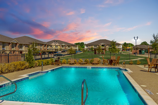 North Greenbriar apartment swimming pool surrounded by green space at dusk