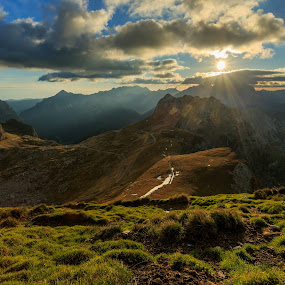 sunset on a pass by Bor Rojnik - Landscapes Mountains & Hills ( clouds, hills, mountains, national park, mangart, mountain, grass, highest, sunset, slovenia, ray of light, autumn colors, road, julian alps, places, shadows,  )
