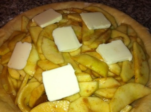 Fill bottom crust with apple mixture.  Place slices of butter on top of...