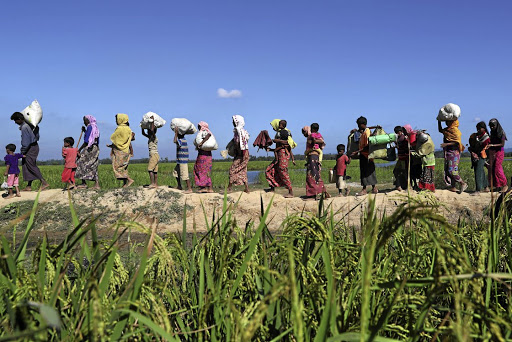Rohingya refugees walk towards a refugee camp in Anjuman Para near Cox's Bazar, Bangladesh, after crossing the border from Myanmar, in November 2017. Picture: REUTERS