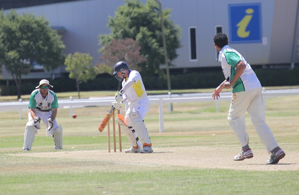 RSL first grade batsman Andrew Irvine, centre, plays an eye-catching late cut during his side's 82-run win against Crossroads Hotel on Saturday. Left is Crossroads wicketkeeper Tim Hayne, and right is Crossroads bowler Craig Trindall.