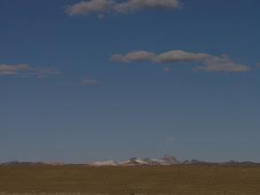 Photo: Nevados (glaciated mountains) rising over the altiplano.
