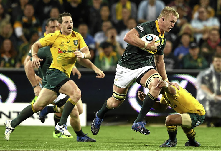Pieter-Steph du Toit of the Springboks is tackled during a match between the Wallabies and the Springboks on Saturday in Perth.