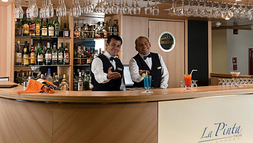 La-Pinta-bar.jpg - Relax at the bar and chat up the bartneder while enjoying spectacular views of the Galapagos on La Pinta.