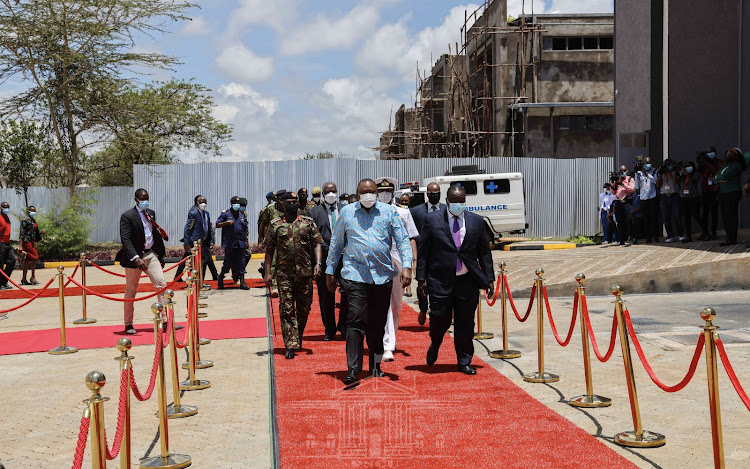 The president walking with the Interior CS Fred Matiang'i on Thursday./PSCU