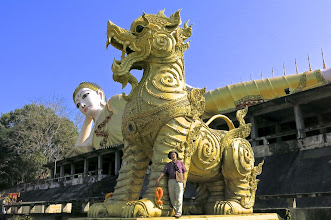 "Photo: Enormous mythical ""singh"" lions flank the reclining Buddha."